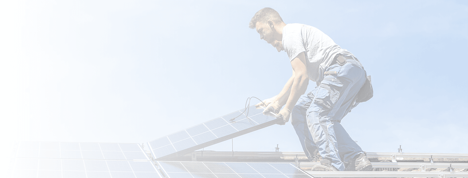Two men installing a solar system