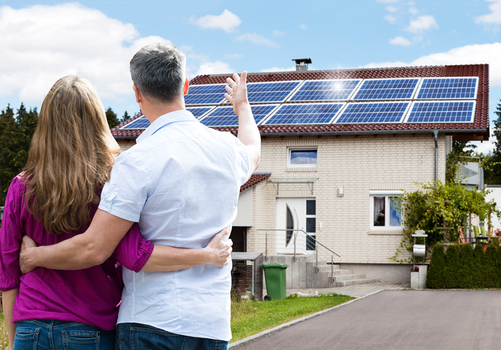 Residential homeowners with solar panels on their roof.